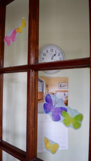 Butterflies greet guests at the front door.