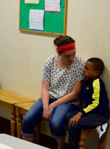 staff member with kid at vincent house